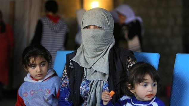 A displaced woman and children from the minority Yazidi sect, who were kidnapped by Islamic State militants of Tal Afar but managed to escape, are seen at a house in Duhok province, northern Iraq, November 24, 2016.