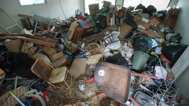 Garbage left by tenants was enough to fill a two-car garage and had to be removed in two dumpsters.