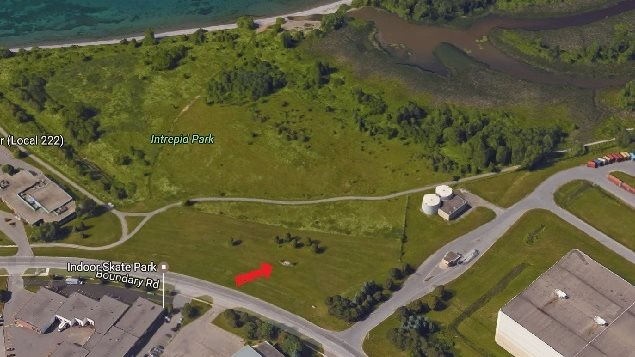 Camp X on the boundary of the municipalities of Whitby and Oshawa, near Toronto. In its day, there would have been nothing near the site. Now all that remains is a tiny memorial indicated by the red arrow