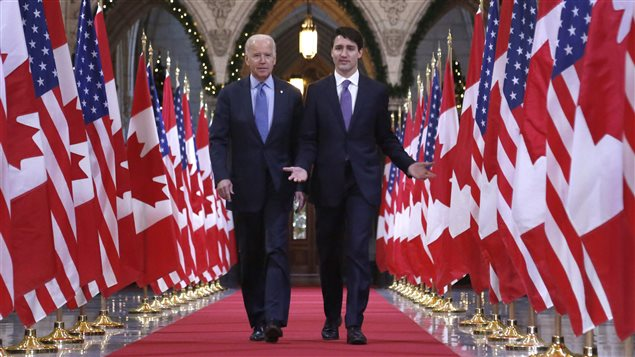 Prime Minister Justin Trudeau and US Vice-President Joe Biden walk down the Hall of Honour on Parliament Hill in Ottawa on Friday, December 9, 2016.
