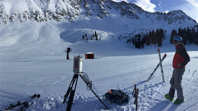 A researcher prepares to use a laser scanning (lidar) unit to scan snow depth at the Arapahoe Ski Basin Ski area in Keystone, Colorado.