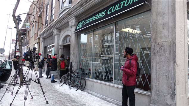 Cameras and 'well-wishers* await the opening of one of the cannabis dispenseries early today in Montreal.