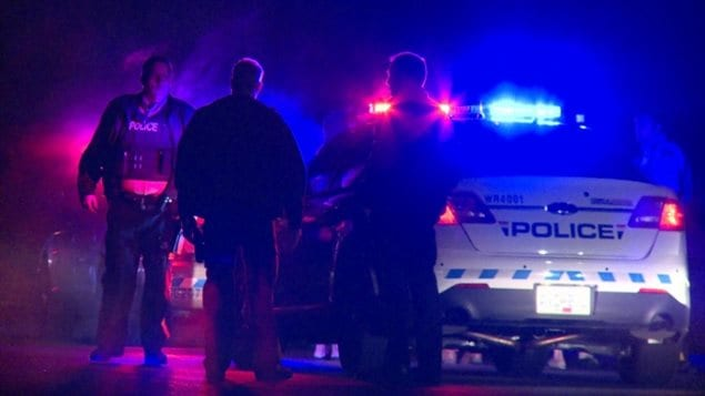 RCMP officers respond to a call following an attack on a home in Surrey, B.C. in January.