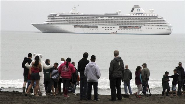 In this Aug. 21, 2016, file photo people prepare to take a polar plunge in the Bering Sea in front of the luxury cruise ship Crystal Serenity, which anchored just outside Nome, Alaska.
