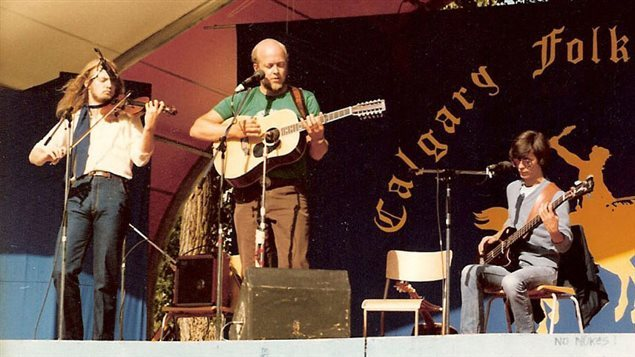 Garnet (left) and Stan Rogers with David Alan Eadie on bass at a Calgary Alberta folk event.