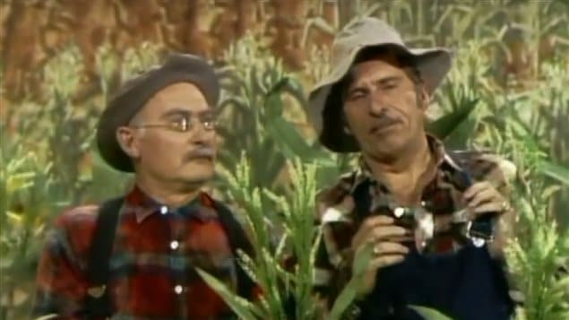 Gordie Tapp (R) with Grandpa Jones telling jokes in the *corn patch* on the country music, variety, and comedy show Hee Haw