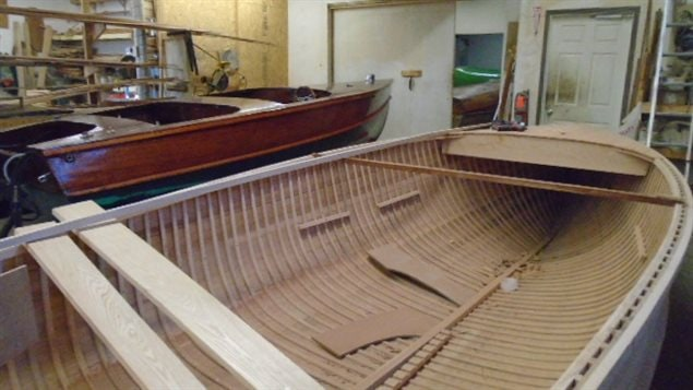 A beautiful boat nearing completion in the back, and another model with a ways to go yet in teh foreground.