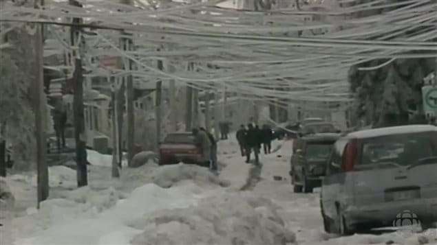 Jan 1998 Montreal streets blocked with ice-covered snow banks frozen solid, with heavily laden power lines drooping and breaking, along with thousands of broken branches littering the streets