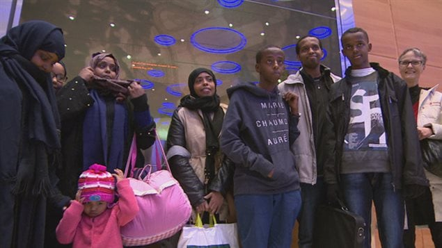 Ten orphaned refugee children arrive in Winnipeg from Saudi Arabia last January.