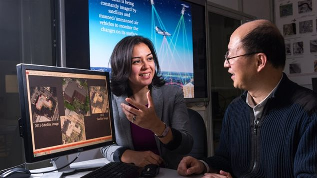 Shabnam Jabari (PhD) discussing the newly developed technology with UNB professor Yun Zhang, Canada Research Chair in Advanced Geomatics Image Processing