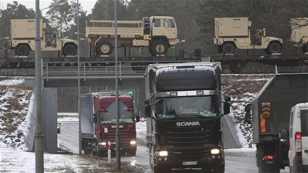U.S. military vehicles are transported by train in Poland on Jan. 12, 2017. The arrival of American troops fulfills a request from Poland which fears Russian aggression.