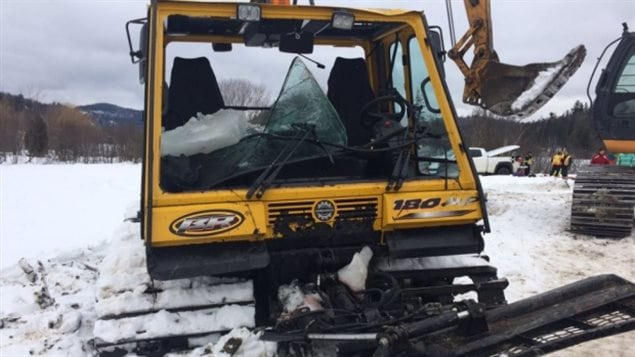 The vehicle used to groom snowmobile trails was recovered from the bottom of the lake about four metres from the surface.