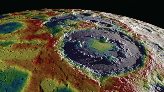 The Schrödinger crater on the Moon, from NASA's GRAIL project. Terrain image overlaid by free-air gravity field, as described in (3). The more continuous outer ring is the crater rim, and the discontinuous, uneven inner ring surrounding the central greenish-yellow area is the peak ring, similar to the feature drilled at Chicxulub and described by Morgan et al.