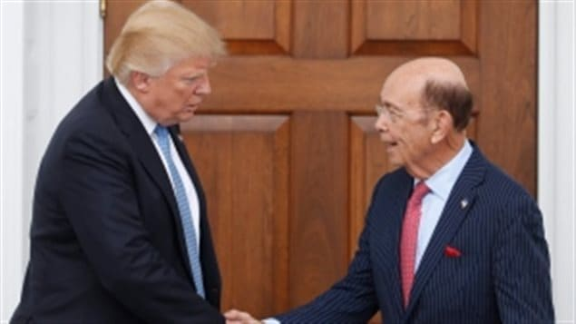 US President Trump and his choice for Secretary of Commerce , billionaire Wilbur Ross. Both have said NAFTA and other trade deals have to be renegotiated.
