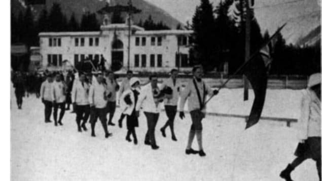The official Canadian delegation at *International Sports Week* 1924, Chamonix, France. Note the Canadian flag used is the Red Ensign.