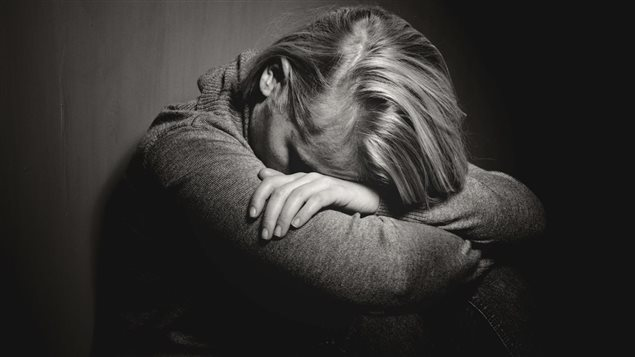 Une femme atteinte de dépression.
