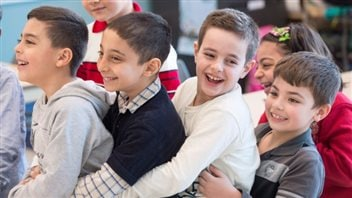 Syrian refugees Jamil Haddad, left, and Tony Batekh, 2nd left, George Louka and Edmon Artin, right, have some fun while they attend French classes at a school last February in Montreal.