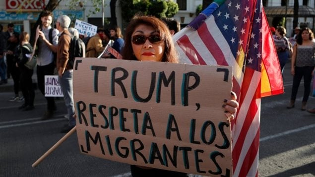 A woman holds a sign that reads in Spanish 'Trump, respect migrants' during a march called by a local women's movement against U.S. President Donald Trump in Mexico City on last Saturday. An influx of Mexican asylum seekers is expected in Canada.