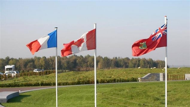 2007 Vimy Memorial France: Canada's offficial national flag, the Maple Leaf in the centre flanked by the French tricolour and the First World War era unofficial Red Ensign flag of Canada