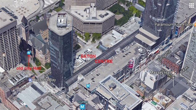 A recent aerial view showing the Eaton Centre and higly built up downtown with towers overshadowing *old City Hall* at left.