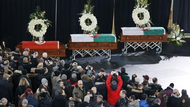 Les cercueils de victimes de l'attentat de Québec, lors des funérailles qui se sont tenues à l'aréna Maurice-Richard, à Montréal.