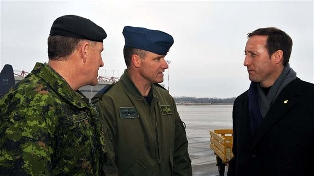 Already a murderer, Col. Russell Williams, centre, commander of CFB Trenton, with Defence Minister Peter MacKay, right, and Gen. Walter Natynczyk, chief of the defence staff, in Trenton on Jan. 17, 2010