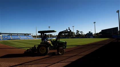 A worker grooms the dirt in Dunedin on Sunday.