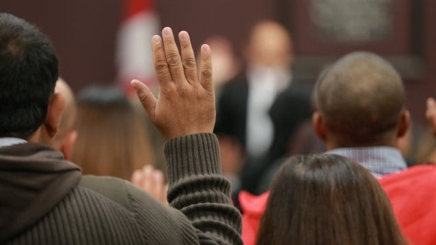 Fewer hands are being raised for the citizenship oath since application fees were raised.