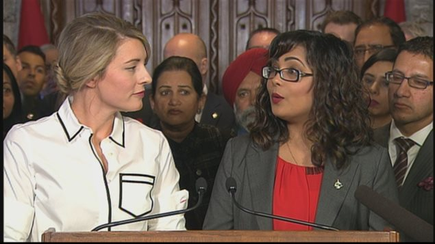 Heritage Minister Mélanie Joly(left) and Liberal MP Iqra Khalid were among those at a news conference Wednesday on Parliament Hill in Ottawa ahead of the debate on M-103, which calls on the government to condemn Islamophobia.