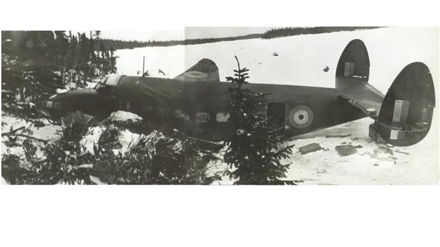 Composite of two photos of the crashed plane in 1941 sometime after rescue and recovery of the pilot and the bodies.