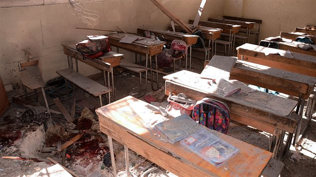 An image shows a pool of blood and damage at a classroom after it was reportedly hit by rebel rocket fire in the Furqan neighbourhood of the government-held side of west Aleppo, on November 20, 2016. At least seven children were killed by rebel rocket fire that hit a school in the government-held west of Aleppo city, state media said.