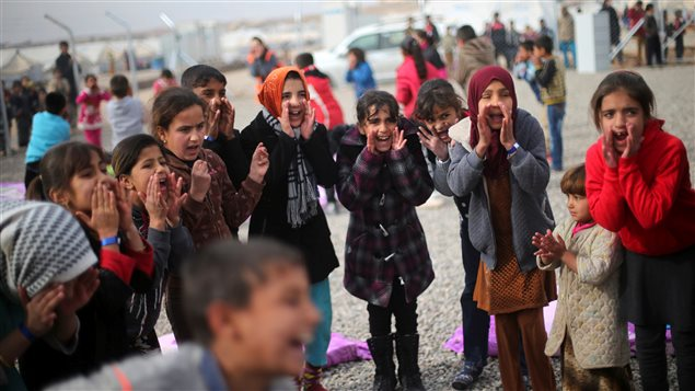 Displaced Iraqi girls sing outside tent schools set by United Nations Children's Fund (UNICEF) at Hassan Sham camp, east of Mosul, Iraq December 8, 2016.