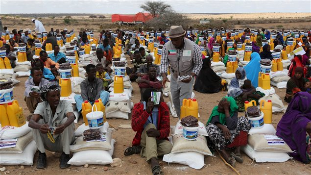 Internally displaced people receive assistance from African Muslim Agency near Adbuqadir town of Awdal region, Somaliland April 11, 2016. Across the Horn of Africa, millions have been hit by the severe El Nino-related drought.