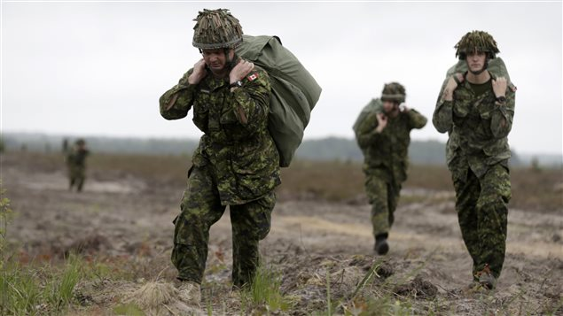 In this June 12, 2014 photo Canada's paratroopers take part in a U.S.-led exercise in Latvia, Lithuania and Estonia, named *Saber Strike*, which involved around 4,700 soldiers from 10 countries.
