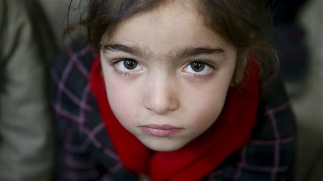 Gharam, 5, an orphan, attends a gathering organized by Damascus Lovers, a group that helps with social support for orphans, in Harasta, in the eastern Damascus suburb of Ghouta, Syria January 30, 2016.