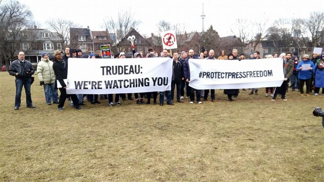 At rallies like this one in Toronto, journalists warn the prime minister they are watching to see whether he will create a press shield law and change the anti-terrorism law.