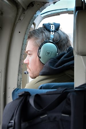 : From a helicopter, Jeff Saarela surveys the tundra for a place rich in plant life.