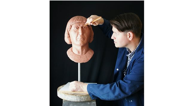Portraitist Christian Corbet works on a clay bust of Robert the Bruce, which included collaborative research with Western Anthropology professor Andrew Nelson. The bust is the first commissioned by the Bruce family, based on evidence from a cast of the king's skull. Nelson's research concluded the skull showed no signs of leprosy, despite contemporary and later rumours Robert the Bruce had the disease.