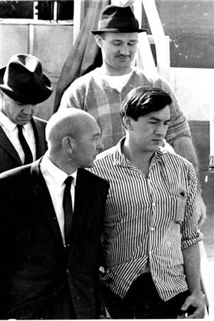 Leishman (top right) in custody after being returned from Indiana