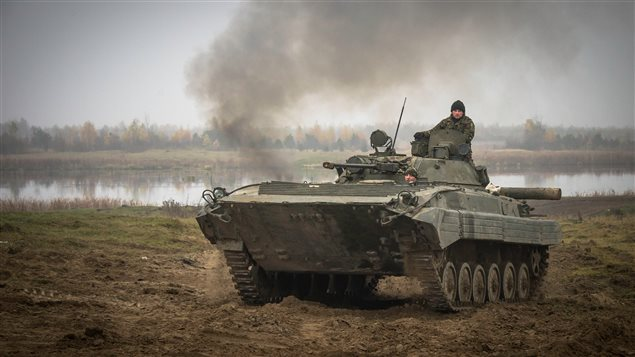 Starychi, Ukraine. 6 November 2015 – Ukrainian soldiers manoeuvre an armoured vehicle on a live range at the International Peacekeeping and Security Centre (IPSC) during Operation UNIFIER.