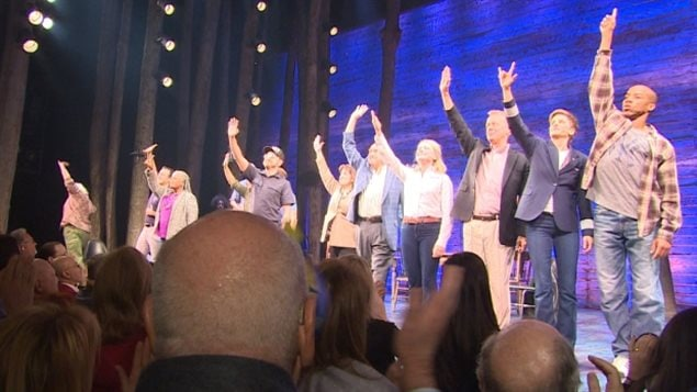 The cast of Come From Away  take a bow to an Opening Night standing ovation at Broadway's Gerald Schoenfeld Theatre Sunday in New York.