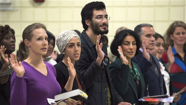 New Canadians took the oath of citizenship in October 2014. One in five Canadians are immigrants, according to figures from 2011.