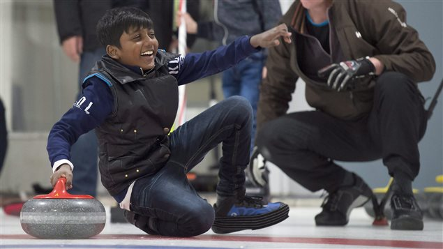 Arun Daniel from Sri Lanka doesn't seem to mind taking a spill while getting tips on curling.