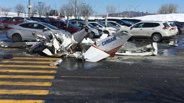 One of the two planes landed in the mall's parking lot.