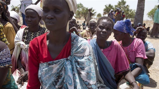 South Sudanese women wait for food aid in South Sudan. The government is said to be blocking desperately needed aid.
