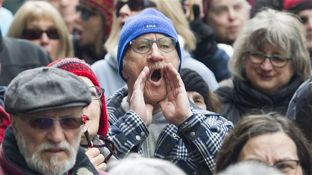Protesters voiced their anger over executive pay hikes outside Bombardier's Montreal headquarters.