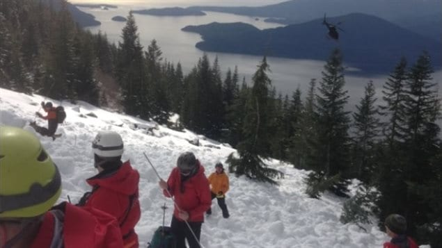 Searchers use probes to search for the bodies of five hikers after they fell 500 metres from the top of Mt. Harvey near Lions Bay B.C. (Chilliwack SAR/Twitter)
