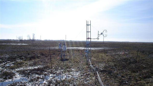 'Monitoring equipment over thawing field at Glenlea, University of Manitoba research station'.