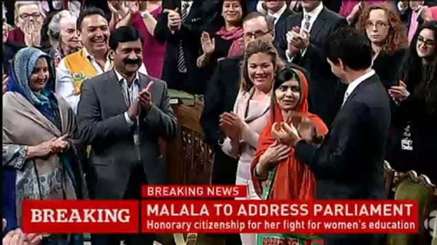 Pakistani activist and Nobel Peace Prize winner Malala Yousafzai, left, is presented with an honorary Canadian citizenship by Prime Minister Justin Trudeau on Parliament Hill Wednesday.