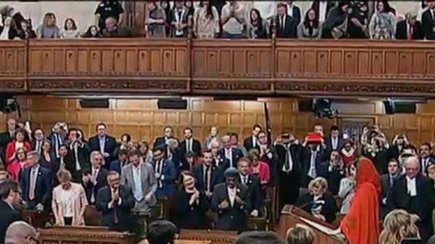 Malala Yousafzai receives a standing ovation from Canadian politicians and visitors in the public gallery